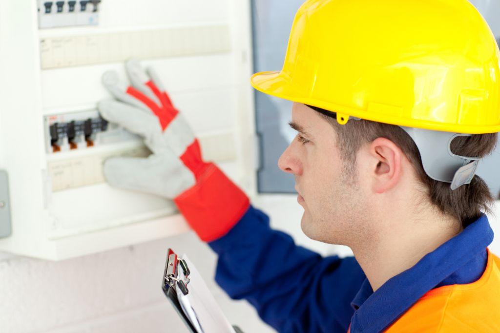 Electrican Mending Circuit Box -iStock_000013541628_Medium