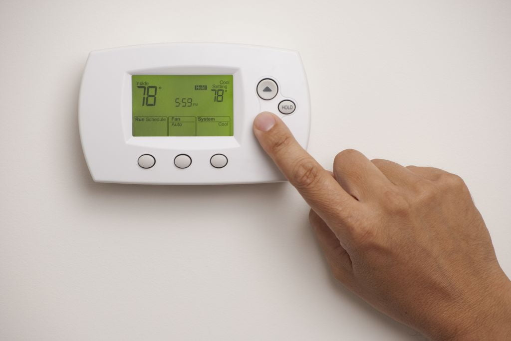 Digital Thermostat and male hand
