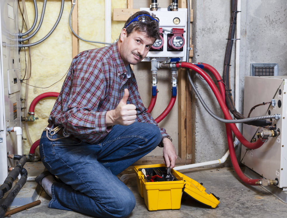 Man Performing Maintenance on a Heater