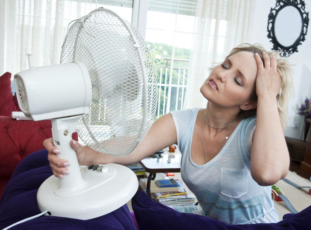 Woman Cooling Herself