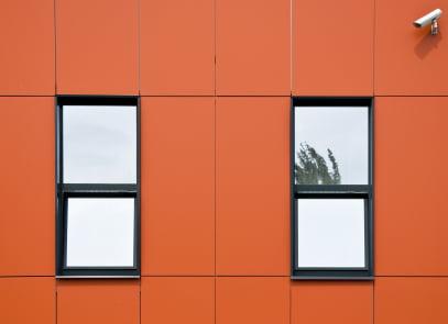 Orange facade of aluminum panels.