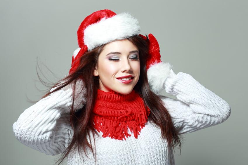 Santa girl with closed eyes
