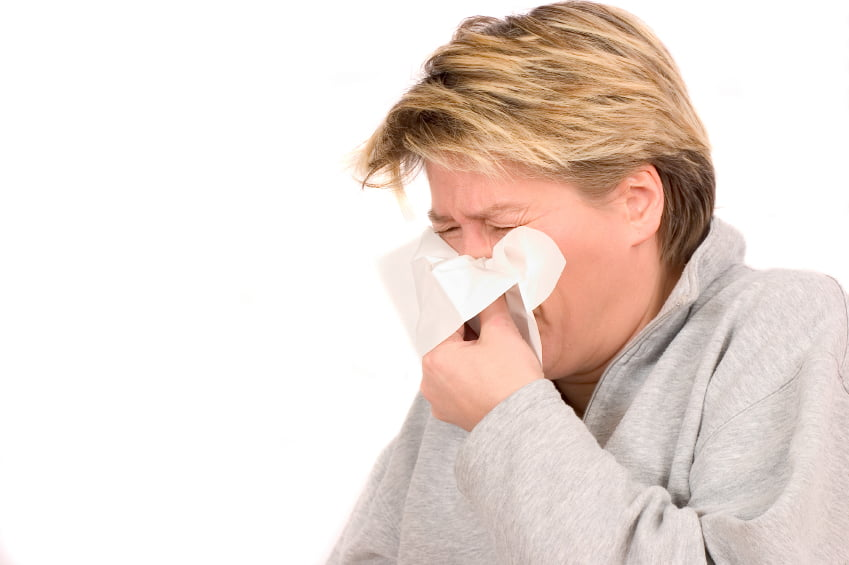 woman sneezing in tissue  iStock_000001177785_Small